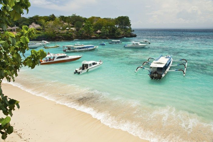 Mooring of boats in a bay of tropical island Lembongan