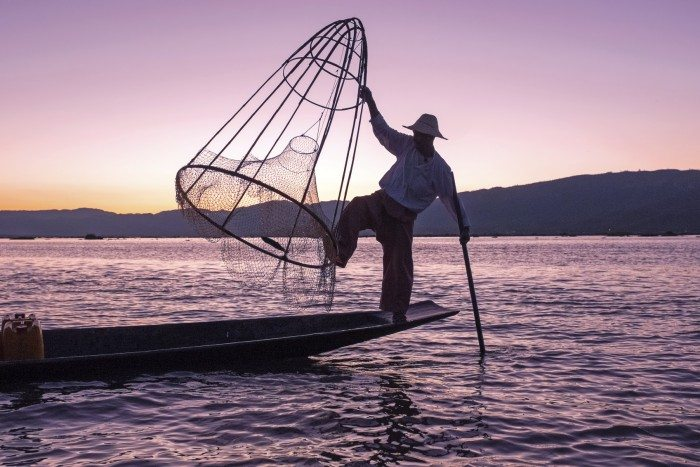 Silhouette of fisherman at sunset Inle Lake Burma Myanmar