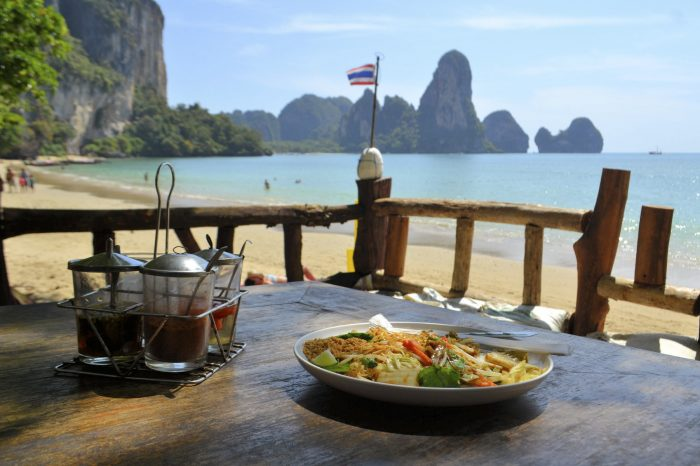 Pad Thai with chicken, traditional dish with an ocean background at Tonsai beach